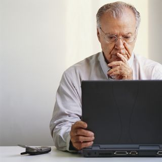Older workers, man at laptop computer